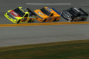 Matt Crafton, driver of the #88 Hormel/Menards Toyota, leads John Wes Townley, driver of the #05 Zaxby's Chevrolet, and Ben Kennedy, driver of the #11 Local Motors Toyota, during the NASCAR Camping World Truck Series fred's 250 at Talladega Superspeedway on October 24, 2015 in Talladega, Alabama.