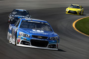 Dale Earnhardt Jr., driver of the #88 Nationwide Chevrolet, leads a pack of cars during the NASCAR Sprint Cup Series Axalta 'We Paint Winners' 400 at Pocono Raceway on June 7, 2015 in Long Pond, Pennsylvania.