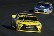 Matt Kenseth, driver of the #20 Dollar General Toyota, leads Dale Earnhardt Jr., driver of the #88 Nationwide Chevrolet, during the NASCAR Sprint Cup Series SYLVANIA 300 at New Hampshire Motor Speedway on September 27, 2015 in Loudon, New Hampshire.