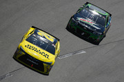 Matt Kenseth, driver of the #20 Dollar General Toyota, races Dale Earnhardt Jr., driver of the #88 Mountain Dew Chevrolet, during the NASCAR Sprint Cup Series TOYOTA OWNERS 400 at Richmond International Raceway on April 24, 2016 in Richmond, Virginia.
