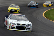 Dale Earnhardt Jr., driver of the #88 Microsoft Chevrolet, leads a pack of cars during the NASCAR Sprint Cup Series Windows 10 400 at Pocono Raceway on August 2, 2015 in Long Pond, Pennsylvania.