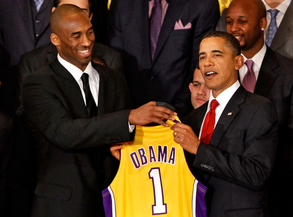 Kobe Bryant Los Angeles Lakers guard Kobe Bryant (L) presents a jersey to
