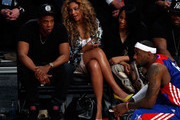 Rapper Jay-Z and Beyonce look over at LeBron James #6 of the Miami Heat and the Eastern Conference during the 2013 NBA All-Star game at the Toyota Center on February 17, 2013 in Houston, Texas. NOTE TO USER: User expressly acknowledges and agrees that, by downloading and or using this photograph, User is consenting to the terms and conditions of the Getty Images License Agreement.