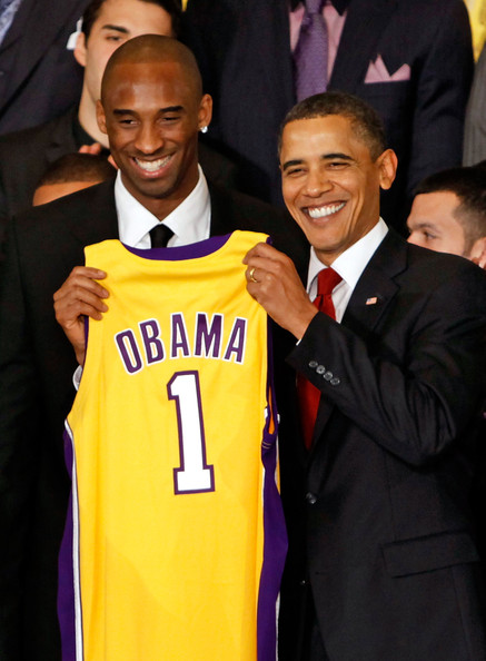 Kobe Bryant President Barack Obama (R) poses for photographs with Kobe Bryant (L) and members of the National Basketball Association 2009 champions Los Angeles Lakers in the East Room of the White House January 25, 2010 in Washington, DC.  The Lakers bested the Orlando Magic to win the NBA Finals in 2009.