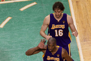 DJ Mbenga #28, Kobe Bryant #24 and Pau Gasol #16 of the Los Angeles Lakers celebrate the Lakers' win over the Boston Celtics in Game Three of the 2010 NBA Finals on June 8, 2010 at TD Garden in Boston, Massachusetts. NOTE TO USER: User expressly acknowledges and agrees that, by downloading and/or using this Photograph, user is consenting to the terms and conditions of the Getty Images License Agreement.
