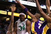 Paul Pierce #34 of the Boston Celtics goes to the basket in the first quarter against Pau Gasol #16, Kobe Bryant #24 and Andrew Bynum #17 of the Los Angeles Lakers during Game Five of the 2010 NBA Finals on June 13, 2010 at TD Garden in Boston, Massachusetts. NOTE TO USER: User expressly acknowledges and agrees that, by downloading and/or using this Photograph, user is consenting to the terms and conditions of the Getty Images License Agreement.