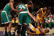 Pau Gasol #16 and Lamar Odom #7 help up teammate Kobe Bryant #24 of the Los Angeles Lakers in the fourth quarter of Game Six of the 2010 NBA Finals against the Boston Celtics at Staples Center on June 15, 2010 in Los Angeles, California.  NOTE TO USER: User expressly acknowledges and agrees that, by downloading and/or using this Photograph, user is consenting to the terms and conditions of the Getty Images License Agreement.