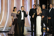 """In this handout photo provided by NBCUniversal Media, LLC,  David Heyman accepts the award for BEST MOTION PICTURE – MUSICAL OR COMEDY for """"Once Upon a Time...in Hollywood"""" onstage, with Shannon McIntosh, Quentin Tarantino, Margot Robbie, Pierce Brosnan and Will Ferrell, during the 77th Annual Golden Globe Awards at The Beverly Hilton Hotel on January 5, 2020 in Beverly Hills, California."""