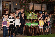 """The cast of """"Parenthood"""" pose at NBC's """"Parenthood"""" 100th episode cake-cutting ceremony at Universal Studios on November 7, 2014 in Universal City, California."""