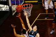 Demitrius Conger of the Hawks goes up against Tom Abercrombie of the Breakers during the round 19 NBL match between the New Zealand Breakers and the Illawarra Hawks at North Shore Events Centre on February 16, 2018 in Auckland, New Zealand.