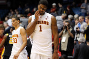 Alex Stepheson #1 and Garrett Jackson #33 of the USC Trojans walk off the court after being defeated by the Virginia Commonwealth Rams during the first round of the 2011 NCAA men's basketball tournament at UD Arena on March 16, 2011 in Dayton, Ohio.