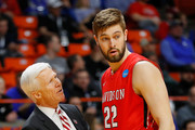 Head coach Bob McKillop of the Davidson Wildcats talks with Will Magarity #22 in the first half against the Kentucky Wildcats during the first round of the 2018 NCAA Men's Basketball Tournament at Taco Bell Arena on March 15, 2018 in Boise, Idaho.
