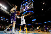 Thomas Walkup #0 of the Stephen F. Austin Lumberjacks looks to throw in against Nathan Adrian #11 of the West Virginia Mountaineers in the first half during the first round of the 2016 NCAA Men's Basketball Tournament at Barclays Center on March 18, 2016 in the Brooklyn borough of New York City.