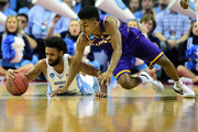 Joel Berry II #2 of the North Carolina Tar Heels and Greg Jones #1 of the Lipscomb Bisons dive for the ball in their game during the first round of the 2018 NCAA Men's Basketball Tournament at Spectrum Center on March 16, 2018 in Charlotte, North Carolina.