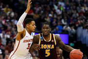 A.J. English #5 of the Iona Gaels drives the ball around Hallice Cooke #3 of the Iowa State Cyclones during the first round of the 2016 NCAA Men's Basketball Tournament at the Pepsi Center on March 17, 2016 in Denver, Colorado.