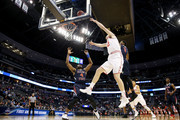 Jakob Poeltl #42 of the Utah Utes goes up against Karachi Edo #4 and Paul Watson #3 of the Fresno State Bulldogs in the first half during the first round of the 2016 NCAA Men's Basketball Tournament at Pepsi Center on March 17, 2016 in Denver, Colorado.