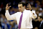 Head coach Mike Krzyzewski of the Duke Blue Devils instructs his team against the Syracuse Orange during the second half in the 2018 NCAA Men's Basketball Tournament Midwest Regional at CenturyLink Center on March 23, 2018 in Omaha, Nebraska. The Duke Blue Devils defeated the Syracuse Orange 69-65.
