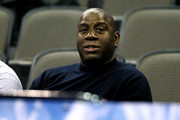 Former NBA player Magic Johnson watches the game between the Kansas Jayhawks and the Clemson Tigers during the first half in the 2018 NCAA Men's Basketball Tournament Midwest Regional at CenturyLink Center on March 23, 2018 in Omaha, Nebraska.