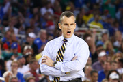 Head coach Billy Donovan of the Florida Gators reacts in the first half against the Florida Gulf Coast Eagles during the South Regional Semifinal round of the 2013 NCAA Men's Basketball Tournament at Dallas Cowboys Stadium on March 29, 2013 in Arlington, Texas.