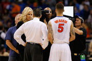 Broadcaster Kristine Leahy interviews head coach Billy Donovan and Scottie Wilbekin #5 of the Florida Gators after the Gators defeated the Pittsburgh Panthers 61-45 on the court during the third round of the 2014 NCAA Men's Basketball Tournament at Amway Center on March 22, 2014 in Orlando, Florida.