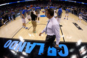 Head coach Billy Donovan of the Florida Gators walks by his team as they warm up during halftime against the Pittsburgh Panthers during the third round of the 2014 NCAA Men's Basketball Tournament at Amway Center on March 22, 2014 in Orlando, Florida.