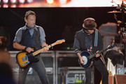 Singer Bruce Springsteen (L) and guitarist Nils Lofgren perform onstage at the Capital One JamFest during the NCAA March Madness Music Festival - Day 3 at Reunion Park on April 6, 2014 in Dallas, Texas.