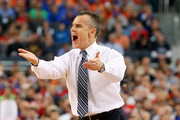 Head coach Billy Donovan of the Florida Gators motions to his players during the NCAA Men's Final Four Semifinal against the Connecticut Huskies at AT&T Stadium on April 5, 2014 in Arlington, Texas.