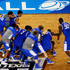 Alex Poythress Photos - The Kentucky Wildcats celebrate after defeating the Wisconsin Badgers 74-73 in the NCAA Men's Final Four Semifinal at AT&T Stadium on April 5, 2014 in Arlington, Texas. - NCAA Men's Final Four - Semifinals