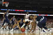 Jalen Brunson #1 of the Villanova Wildcats and Kris Jenkins #2 battle for the ball with Jordan Woodard #10 of the Oklahoma Sooners in the first half during the NCAA Men's Final Four Semifinal at NRG Stadium on April 2, 2016 in Houston, Texas.