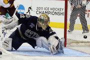 Mike Johnson #32 of the Notre Dame Fighting Irish is unable to stop a shot by Jack Connolly of the Minnesota Duluth Bulldogs  during semifinals of the 2011 NCAA Men's Frozen Four on April 7, 2011 at the Xcel Energy Center in St. Paul, Minnesota.