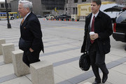 NFL owners Robert Kraft  (L) of the Patriots and Jerry Richardson of the Carolina Panthers arrive for a court ordered mediation at the U.S. Courthouse on April 15, 2011 in Minneapolis, Minnesota. Mediation was ordered after a hearing on an antitrust lawsuit filed by NFL players against the NFL owners when labor talks between the two broke down last month.