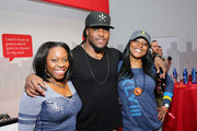 Professional football player Chris Ivory (C) celebrates with guests at the Super Bowl at the Verizon Power House Super Bowl viewing party at Bryant Park on February 2, 2014 in New York City.