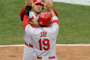 Matt Holliday #7 and Jon Jay #19 of the St. Louis Cardinals celebrate after scoring in the fourth inning against the San Francisco Giants during Game Three of the National League Championship Series at AT&T Park on October 14, 2014 in San Francisco, California.