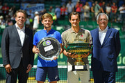 (L-R) tournament director Ralf Weber, David Goffin of Belgium, Roger Federer of Switzerland and CEO of Noventi Dr. Hermann Sommer pose for photographers after the final match of the Noventi Open at Gerry Weber Stadium on June 23, 2019 in Halle, Germany.