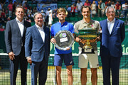 (L-R) Tournament director Ralf Weber, State Premier of North Rhine-Westphalia Armin Laschet, David Goffin of Belgium, Roger Federer of Switzerland and CEO of Noventi Dr. Hermann Sommer pose for photographers after the final match of the Noventi Open at Gerry Weber Stadium on June 23, 2019 in Halle, Germany.