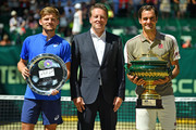 (L-R) David Goffin of Belgium, tournament director Ralf Weber and Roger Federer of Switzerland pose for photographers after the final match of the Noventi Open at Gerry Weber Stadium on June 23, 2019 in Halle, Germany.