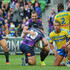 Cameron Smith congratulates Bryan Norrie of the Storm after he scored a try during the round 15 NRL match between the Melbourne Storm and the Parramatta Eels at AAMI Park on June 22, 2014 in Melbourne, Australia.