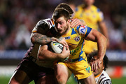Kieran Foran of the Sea Eagles is tackled by Josh McGuire and Sam Thaiday of the Broncos during the round 21 NRL match between the Manly-Warringah Sea Eagles and the Brisbane Broncos at Brookvale Oval on August 1, 2014 in Sydney, Australia.