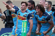 Mitch Rein and Kevin Proctor, of the Titans celebrate a try during the round five NRL match between the Gold Coast Titans and the Manly Sea Eagles at Marley Brown Oval on April 8, 2018 in Gladstone, Australia.