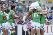 Raiders players celebrate after Jarrod Croker scored a try during the round six NRL match between the Canberra Raiders and the New Zealand Warriors at Canberra Stadium on April 8, 2012 in Canberra, Australia.