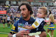 Johnathan Thurston of the Cowboys walks on the field with his daughter Frankie at the start of the round seven NRL match between the North Queensland Cowboys and the New Zealand Warriors at 1300SMILES Stadium on April 18, 2015 in Townsville, Australia.