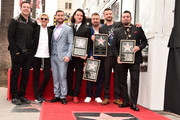 Carson Daly, Ellen Degeneres, Lance Bass, JC Chasez, Joey Fatone, Justin Timberlake and Chris Kirkpatrick at a ceremony honoring 'NSYNC with a star on the Hollywood Walk of Fame on April 30, 2018 in Hollywood, California.