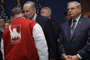 FealGood Foundation co-founder John Feal (L) thanks Sen. Chuck Schumer (D-NY) (C) and Sen. Robert Menendez (D-NJ) after the Zadroga 9/11 health and compensation programs were included in the omnibus spending bill that passed Congress at the U.S. Capitol December 18, 2015 in Washington, DC. With a public awareness campaign lead by former Daily Show host Jon Stewart, the Zadroga legislation will provide money for healthcare for first responders and others suffering from diseases from the 9/11 attacks and for the families of those who have died.