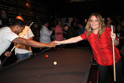 (L-R) Terrell Thomas and Angie Martinez attend the NY Giants Justin Tuck 4th Annual celebrity billiards tournament at Slate NYC on May 31, 2012 in New York City.