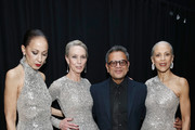 Deisnger Naeem Khan (2ndR) poses with models (L-R) Pat Cleveland, Karen Bjornson and Alva Chinn backstage for Naeem Khan fashion show during New York Fashion Week: The Shows at Gallery I at Spring Studios on February 12, 2019 in New York City.