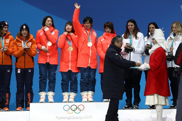 Medal Ceremony - Winter Olympics Day 13 [social group,stage equipment,team,event,technology,silver medal,competition,medal,fun,uniform,gold medalists,miho takagi,ayaka kikuchi,nana takagi,ayano sato,speed skating - ladies team pursuit,japan,medal ceremony,winter olympics,medal ceremony]