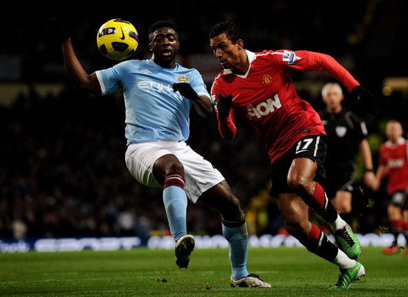 Nani Kolo Toure of Manchester City battles for the ball with Nani of Manchester United during the Barclays Premier League match between Manchester City and Manchester United at the City of Manchester Stadium on November 10, 2010 in Manchester, England.