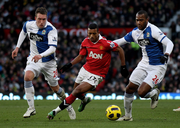 Nani Phil Jones (L) and Herold Goulon of Blackburn Rovers compete with Nani of Manchester United during the Barclays Premier League match between Manchester United and Blackburn Rovers at Old Trafford on November 27, 2010 in Manchester, England.