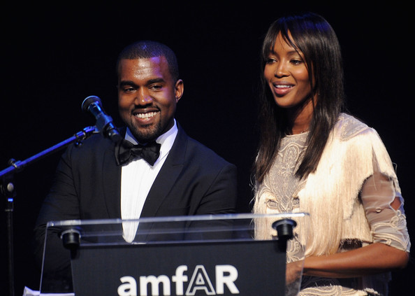 Naomi Campbell Kanye West and Naomi Campbell onstage at amfAR's Cinema Against AIDS Gala during the 64th Annual Cannes Film Festival at Hotel Du Cap on May 19, 2011 in Antibes, France.