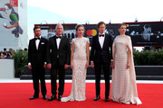 (L-R) Guest with Vlad Ivanov, Evelin Dobos, Laszlo Nemes and Juli Jakab walk the red carpet ahead of the 'Napszallta (Sunset)' screening during the 75th Venice Film Festival at Sala Grande on September 3, 2018 in Venice, Italy.